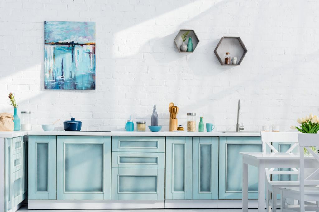 interior of bright elegant kitchen with kitchenware, decor and sunlight